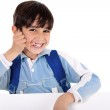 Smiling young boy acts as he talks over — Stock Photo