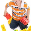 Young boy playing with building blocks — Stock Photo
