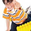 Boy shows ok sign when playing — Stock Photo