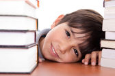 Happy young school boy surrounded — Stock Photo