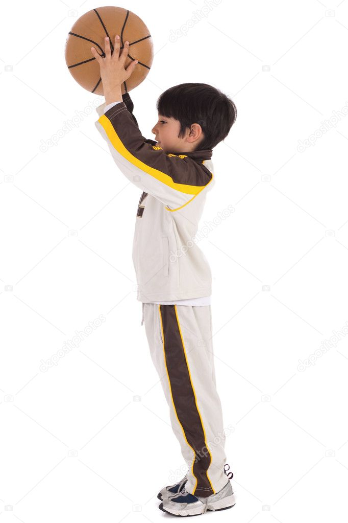 Little kid while throwing the basketball on white isolated background  Stock Photo #2277767