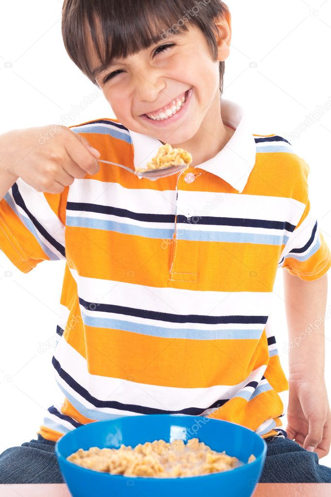 Young boy eating his breakfast on isolated white background — Stock Photo #2277972