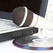 The microphone lays on notebook — Stock Photo #1126175