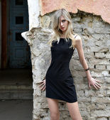 The girl the blonde in a black dress — Stock Photo