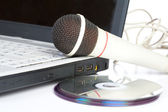 The microphone lays on notebook — Stock Photo