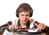 The young man listens to vinylic disk — Stock Photo