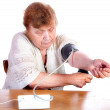 The old woman measures arterial pressure — Stock Photo