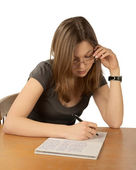 The girl in glasses writes to writing-bo — Stock Photo