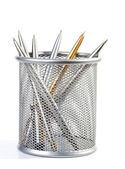 Metal ball-point pens in a support — Stock Photo