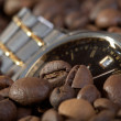 Watch in a heap coffee grains — Stock Photo