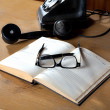 The old daily log with glasses and phone — Stok fotoğraf