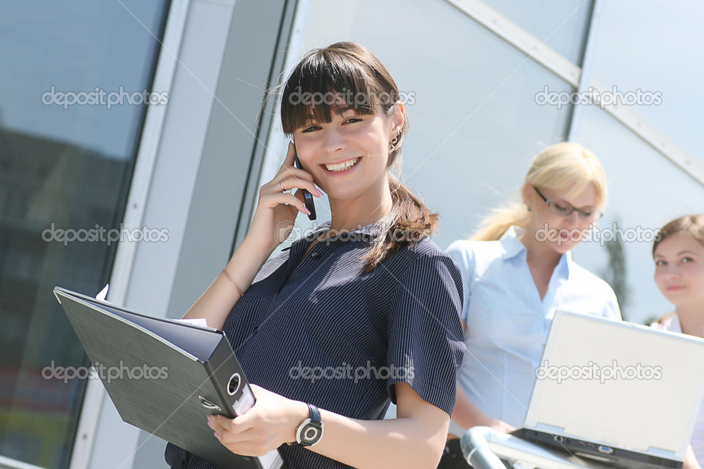 Businesswoman using a mobile phone as a mode of communication  Stock Photo #1078935