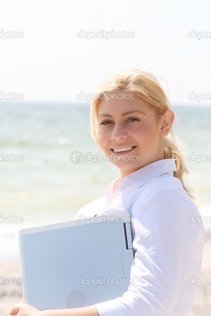 Young business girl holding laptop — Stock Photo #1078949