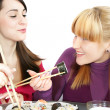 Womans eating salmon sushi — Stock Photo #1098170