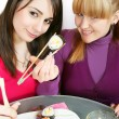 Womans eating salmon sushi — Stock Photo