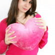 Woman with a big red heart — Stock Photo