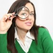 Young studentlooking through loupe — Stock Photo