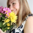 Woman with bunch of flowers - Stock Photo