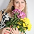 Woman with bunch of flowers — Stock Photo