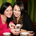 Girls with phone — Stock Photo #1171925