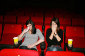 Girls are in the cinema, — Stock Photo
