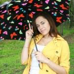 Woman holding a umbrella — Stock Photo