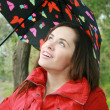Stock Photo: Woman holding a umbrella