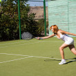 Girl plays tennis — Stock Photo #1094589