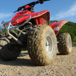 Stock Photo: ATV in mud and dust