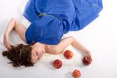 Lying lady with apples — Stock Photo