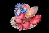 Umělé růže ručně — Stock fotografie
