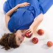 Lying lady with apples - Stock Photo