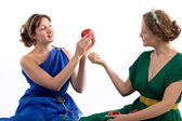 Two ladies and apples — Stock Photo