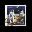 Royalty-Free Stock Photo: Astronaut on the moon, postage stamp