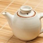 Chinese teapot on bamboo mat — Stock Photo #1083452