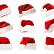 Set of Santa hats isolated on white - Stock Photo