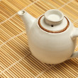 Chinese teapot on bamboo mat - Stock Photo