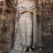 Ancient standing Buddha image - Stock Photo