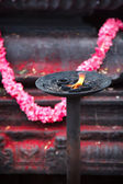 Burning flame in Hindu temple — Stockfoto