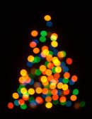Christmas fur tree shaped defocused back — Foto Stock