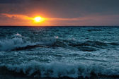 Stormy sunsrise on the sea — Stock Photo