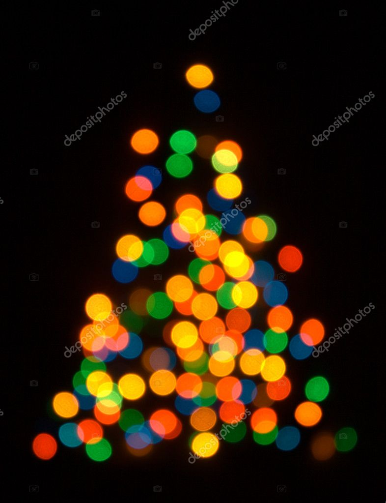 Lights - Christmas fur tree shaped defocused background — Stock Photo #1083292