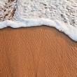 Royalty-Free Stock Photo: Wave surging on sand