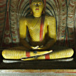 ancient buddha image in dambulla rock te — Stock Photo