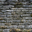 Ancient stone wall texture — Stockfoto