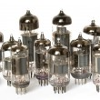 Vacuum tubes on white background - Foto Stock
