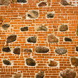Brick wall with embedded stones - Stock Photo