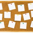 Cork board with pinned white notes — Stock Photo #1093698