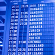 Depature schedule board in asian airport - Stock Photo