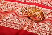 Indian sari with golden bangles — Stock Photo